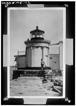 view of lighthouse and dwelling