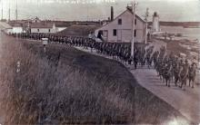 Portsmouth Harbor - c. 1914 - troops marching from fort